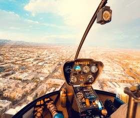 Watching cityscape on helicopter cabin Stock Photo