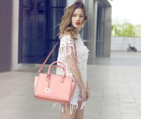 Wear white clothing carrying pink waist bag woman Stock Photo