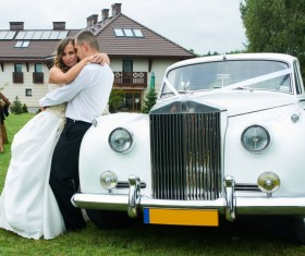 Wedding couple and white wedding car Stock Photo