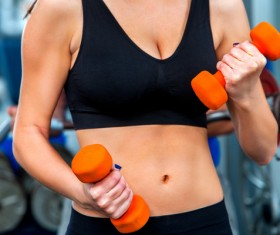 Woman doing arm exercise in gym Stock Photo 01
