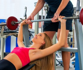 Woman doing arm exercise in gym Stock Photo 04