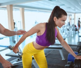 Woman doing arm exercise in the gym Stock Photo 01