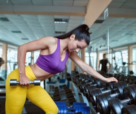 Woman doing arm exercise in the gym Stock Photo 02