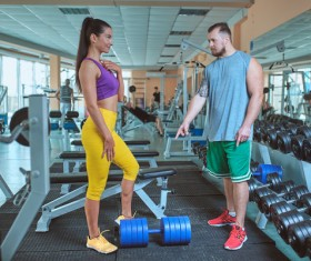Woman doing arm exercise in the gym Stock Photo 03