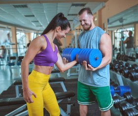 Woman doing arm exercise in the gym Stock Photo 04