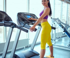 Woman exercising on a treadmill Stock Photo 01