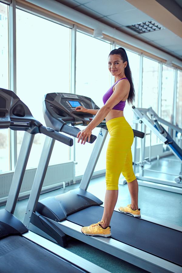 Woman exercising on a treadmill Stock Photo 01