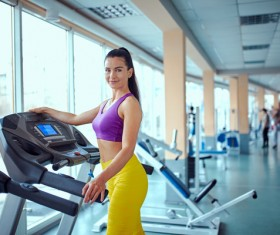 Woman exercising on a treadmill Stock Photo 02