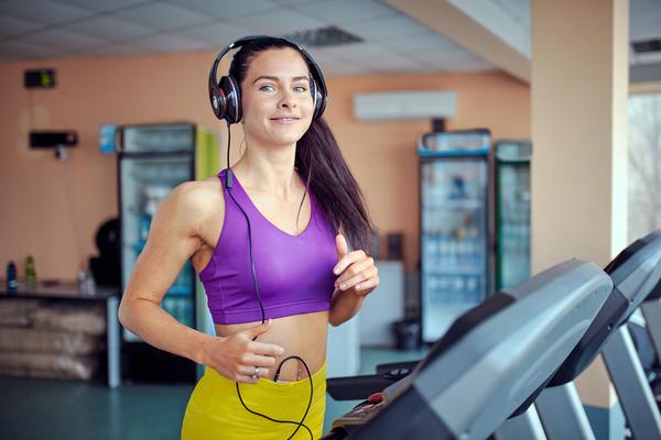 Woman exercising on a treadmill Stock Photo 03
