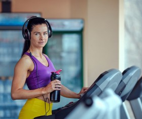 Woman exercising on a treadmill Stock Photo 04