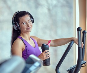 Woman exercising on a treadmill Stock Photo 05