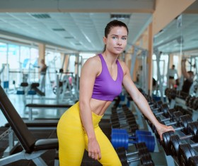 Woman getting ready for exercise in gym Stock Photo