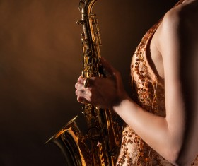 Woman holding blowing saxophone Stock Photo