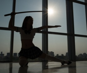 Woman practicing martial arts Stock Photo
