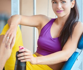 Woman resting after exercise in the gym Stock Photo 01
