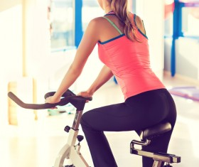 Woman riding spining at gym Stock Photo