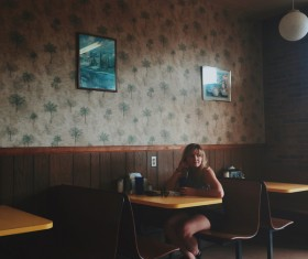 Woman sitting alone in the restaurant Stock Photo