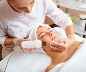 Womens skin massage Stock Photo