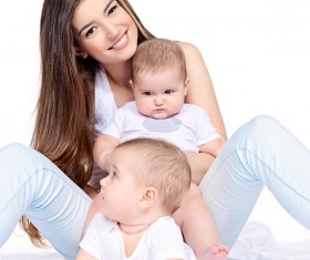 Young beautiful mother and two children Stock Photo 11