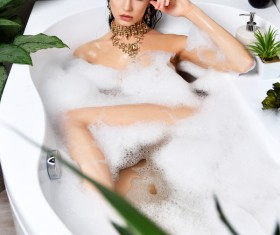 Young beautiful woman lying in bathtub Stock Photo 06