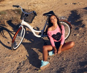 Young girl with bicycle Stock Photo 02
