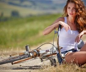 Young girl with bicycle Stock Photo 03