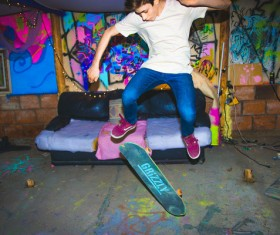 Young man excited with skateboard sports Stock Photo