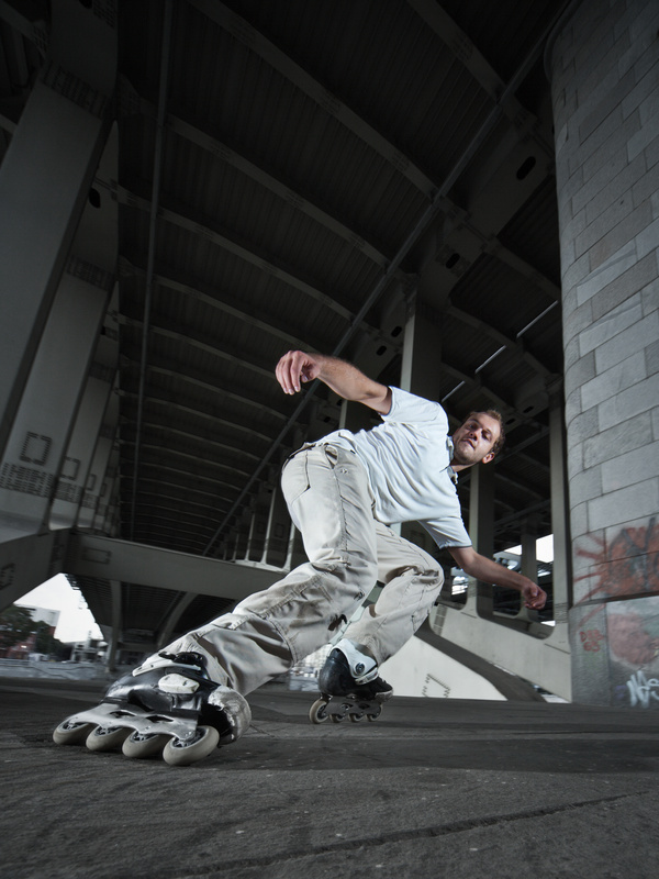 Young people playing roller skating Stock Photo 01
