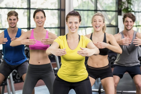 Young people working out in the gym Stock Photo 03