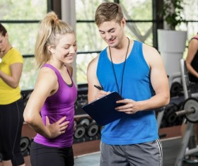 Young people working out in the gym Stock Photo 09