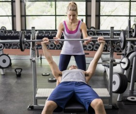 Young people working out in the gym Stock Photo 10