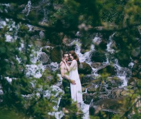 couple posing on wild stream landscape Stock Photo