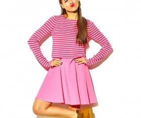funny expressions girl in pink dress Stock Photo