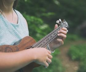 girl playing guitar outdoor Stock Photo