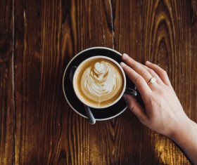 woman hand and coffee cup Stock Photo