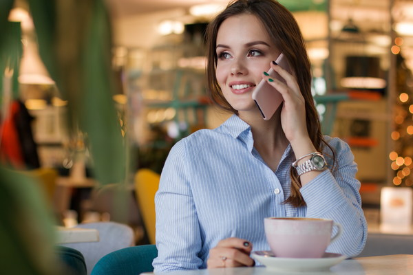 woman on the coffee house call up Stock Photo