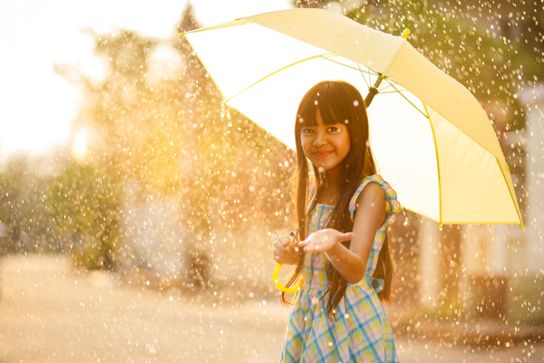 A girl holding an umbrella on a rainy day Stock Photo