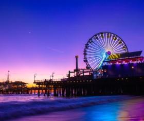 Amusement structure on beach at dusk Stock Photo