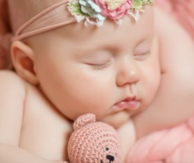 Baby holding knitted bear sleeping Stock Photo 03