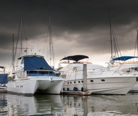 Bad weather yacht moored at the dock Stock Photo