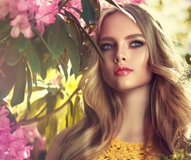 Beautiful girl and blooming flowers Stock Photo 01