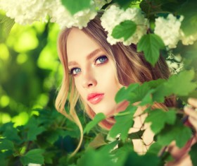 Beautiful girl and blooming flowers Stock Photo 02