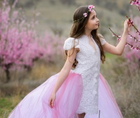 Beautiful little girl posing with flowers Stock Photo