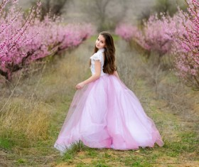 Beautiful little princess in the garden Stock Photo
