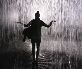 Black and white photo of girl in the rain Stock Photo