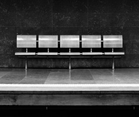 Black white picture of empty seats bench Stock Photo