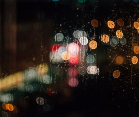 Bokeh light outside of wet glass Stock Photo