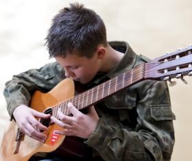 Boy playing guitar Stock Photo