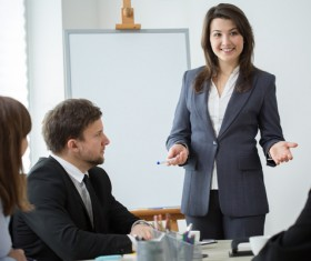 Business woman explaining at conference Stock Photo