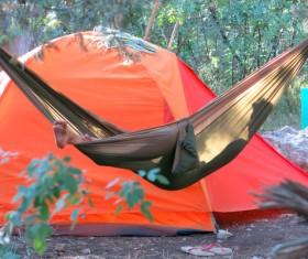 Camping tents and hammocks Stock Photo